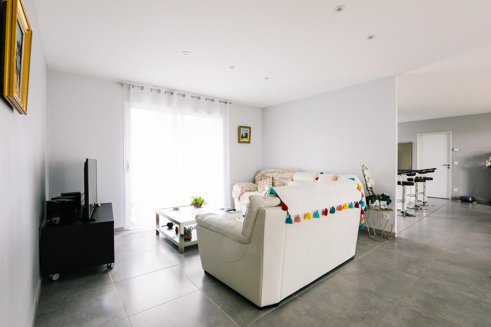 L'espace TV et son canapé